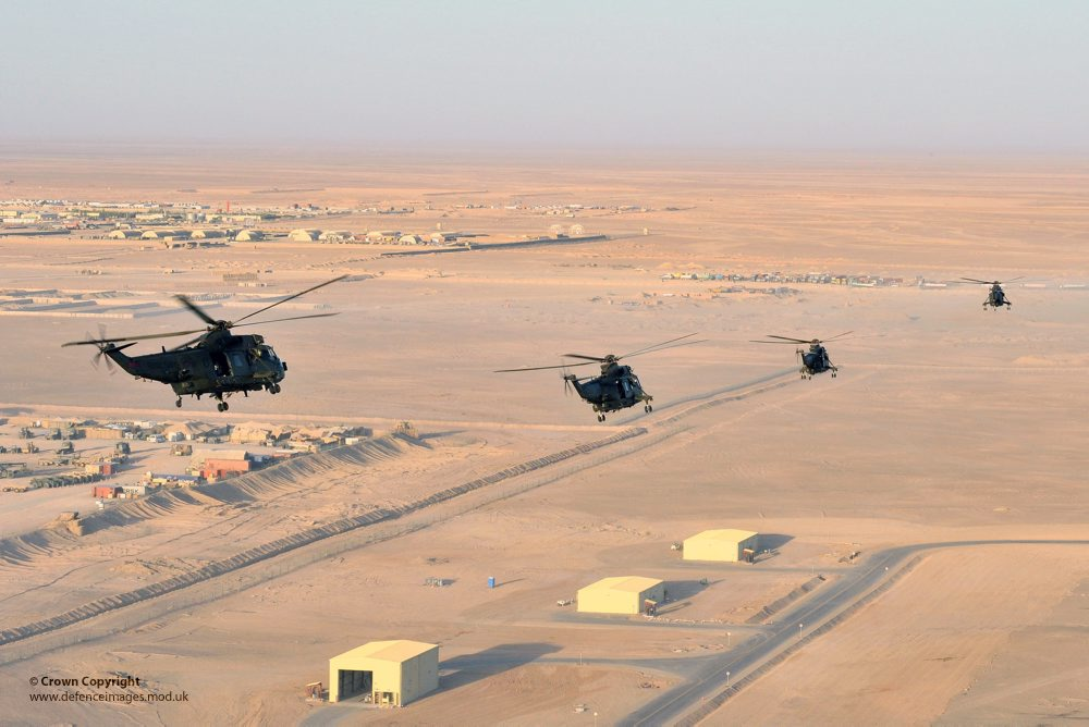 Royal Navy SeaKing Helicopters Fly Over Camp Bastion Afghanistan